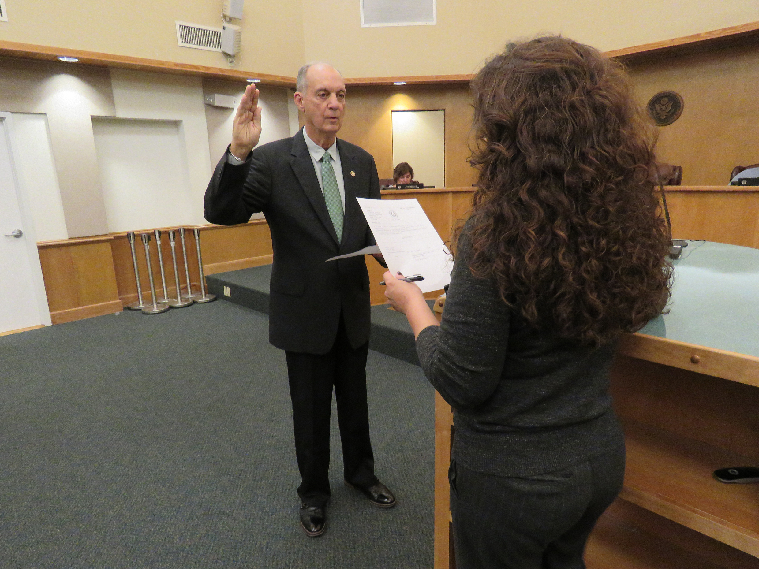 Picture of Wiley Hopkins being sworn-in by City Secretary